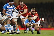Martin Landajo of Argentina passes the ball under pressure from Tomas Francis of Wales. Under Armour 2016 series international rugby, Wales v Argentina at the Principality Stadium in Cardiff , South Wales on Saturday 12th November 2016. pic by Andrew Orchard, Andrew Orchard sports photography