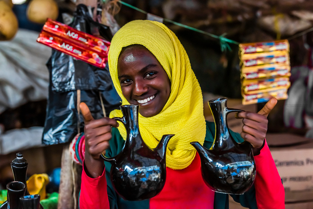 Woman selling jebenas (containers used to brew coffee in the Ethiopian coffee ceremony), in the market in Bahir Dar, Ethiopia.