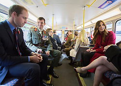 © Licensed to London News Pictures. 07/11/2013.  The Duke and Duchess of Cambridge on board the Royal British Legions Poppy bus today as the charity aimed to collect a million pounds in one day.  The Royal couple met with former and serving soldiers at Kensington Palace and also on High Street Kensington.      Photo credit: Alison Baskerville/LNP