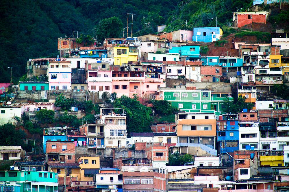 Colorful houses on a hillside in La Guaria, Venezuela.