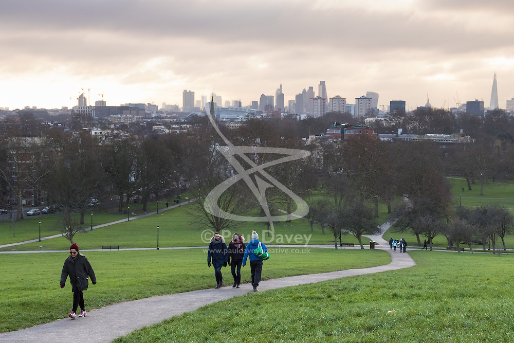 Primrose Hill, London, February 15th 2015. people walk on a chilly early morning on Primrose Hill, overlooking London's skyline.<br /> ///FOR LICENCING CONTACT: paul@pauldaveycreative.co.uk TEL:+44 (0) 7966 016 296 or +44 (0) 20 8969 6875. ©2015 Paul R Davey. All rights reserved.