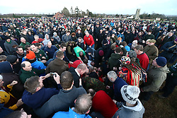 © Licensed to London News Pictures. 06/01/2018. Haxey, UK. Picture shows the start of The Haxey Hood game that is taking place today in the village of Haxey in Lincolnshire. The Haxey Hood is a traditional event that takes place every January & is played by teams from four pubs, the Carpenters Arms, the Duke William Hotel, The Loco & The kings Arms. The game is like a large rugby scrum called the 'sway' which pushes a leather tube called the 'hood' to one of the four pubs, the game is won when a team gets the hood to the front step of the pub & it is touched by the landlord. Photo credit: Andrew McCaren/LNP