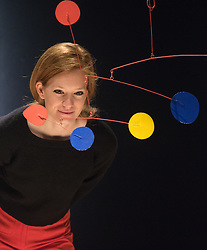 """Christies, St James, London, February 5th 2016. A woman examines  Alexander Calder's standing mobile sculpture """"Crag With Yellow Boomerang and Red Eggplant"""" which is expected to fetch up to £700,000 at acution during the 20th Century Art Sale Preview. ///FOR LICENCING CONTACT: paul@pauldaveycreative.co.uk TEL:+44 (0) 7966 016 296 or +44 (0) 20 8969 6875. ©2015 Paul R Davey. All rights reserved."""