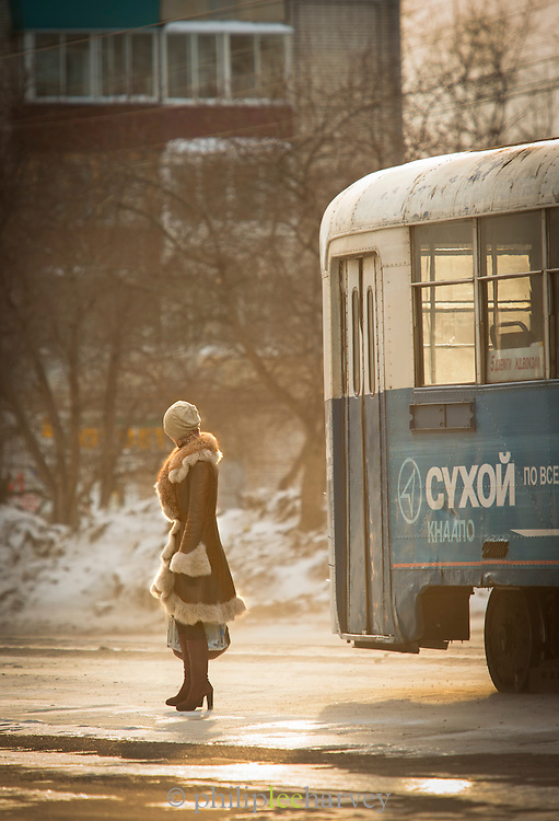 Woman waiting for tram in Komsomolsk-na-Amure.Siberia, Russia