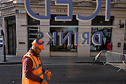Construction workers outside the mens' clothing outfitters Hackett in Philpot Lane in London's Square Mile.