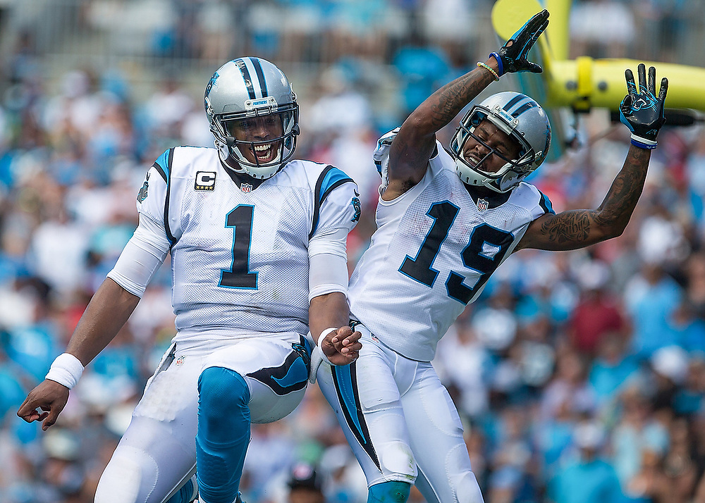 Carolina Panthers quarterback Cam Newton (1) celebrates a touchdown with wide receiver Ted Ginn (19). <br /> San Francisco 49ers vs Carolina Panthers at Bank of America Stadium in Charlotte, N.C., on Sunday, Sept. 18, 2016. <br /> Zach Bland Photo