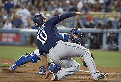 August 11, 2017 - Los Angeles, California, U.S - 11 Aug 2017. The Los Angeles Dodgers play the San Diego Padres in the first  game of a three-game series at Dodger Stadium. Pictured is Dodger Catcher Austin Barnes tagging Padres' Hunter Renfroe out at home base. (Credit Image: © Prensa Internacional via ZUMA Wire)