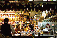 September 1991, Madrid, Spain --- A famous bar in Madrid called the Museo del Jamon, or Museum of Ham, has dozens of hams hanging from the ceiling, mainly of the salt-cured type . --- Image by © Owen Franken/CORBIS