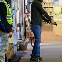 Charles Wommack, the active shooter in the drill makes his way into the Octavia Fellin Public Library Thursday morning followed by Lt. Padavich of the Gallup Police Department.