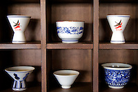 Traditionally, sake was served in wooden box cups known as masu as it was thought that cedar complemented the taste of sake.  Nowadays, sake is more typically served in ceramic cups. The cups used for drinking sake tiny vessels called ochoko.