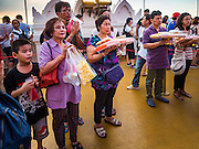 21 NOVEMBER 2015 - BANGKOK, THAILAND: People pray at the Wat Saket temple fair. Wat Saket is on a man-made hill in the historic section of Bangkok. The temple has golden spire that is 260 feet high which was the highest point in Bangkok for more than 100 years. The temple construction began in the 1800s in the reign of King Rama III and was completed in the reign of King Rama IV. The annual temple fair is held on the 12th lunar month, for nine days around the November full moon. During the fair a red cloth (reminiscent of a monk's robe) is placed around the Golden Mount while the temple grounds hosts Thai traditional theatre, food stalls and traditional shows.     PHOTO BY JACK KURTZ