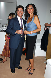 REMI KRUG and MARIE HELVIN at a summer party hosted by champagne house Krug held at Debbenham House, 8 Addison Road, London on 28th June 2005.<br /><br />NON EXCLUSIVE - WORLD RIGHTS