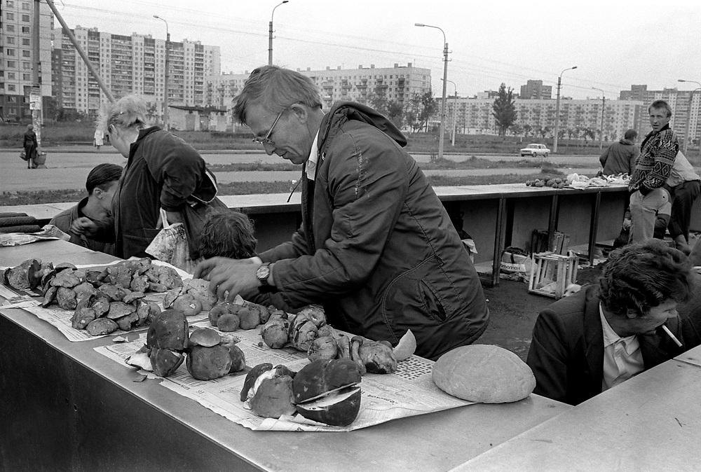 Selling mushrooms in local market.<br /> St Petersburg, Russia, 1994
