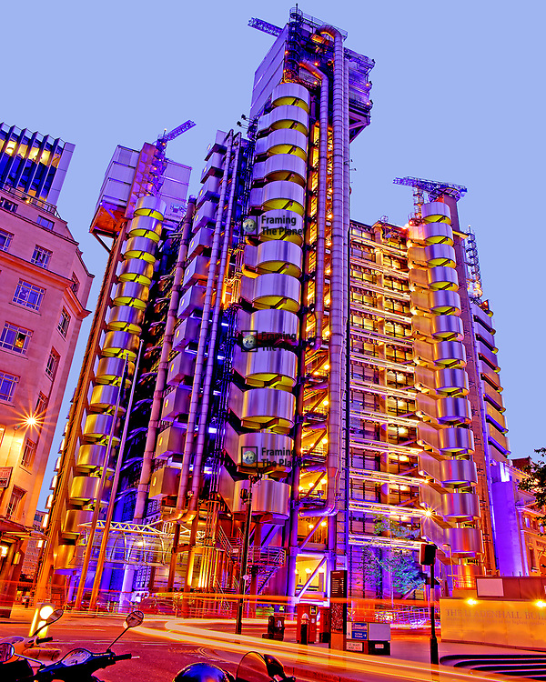 This vibrant and colourful photograph is of the famous Richard Rogers designed Lloyds Building at  Number One Lime Street, London. I have created this image to show the fantastic colour and bold architectural design used to create this building. What I really love about this image is the way we are reminded of the high flying and fast pace of life in the financial heart of the city through the movement added from the blur of car lights mixed in with the amazing lights and texture of the building.<br /> <br /> The Lloyds Building is the centre of insurance trading for Lloyds of London and many of the other businesses it houses on its trading floors. The way all of the pipes, lifts, cables and wires have been hung on the exterior give us a building where we can see the organs and life blood keeping the work inside going and in motion. It enables the person passing on the street to imagine that this is a place of action and to have some idea of the fast pace of life inside.