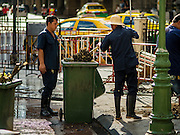 18 AUGUST 2015 - BANGKOK, THAILAND: Workers clean up Erawan Shrine in Bangkok. An explosion at Erawan Shrine, a popular tourist attraction and important religious shrine in the heart of the Bangkok shopping district, killed at least 20 people and injured more than 120 others, including foreign tourists, during the Monday evening rush hour. Twelve of the dead were killed at the scene. Thai police said an Improvised Explosive Device (IED) was detonated at 18.55. Police said the bomb was made of more than six pounds of explosives stuffed in a pipe and wrapped with white cloth. Its destructive radius was estimated at 100 meters.     PHOTO BY JACK KURTZ