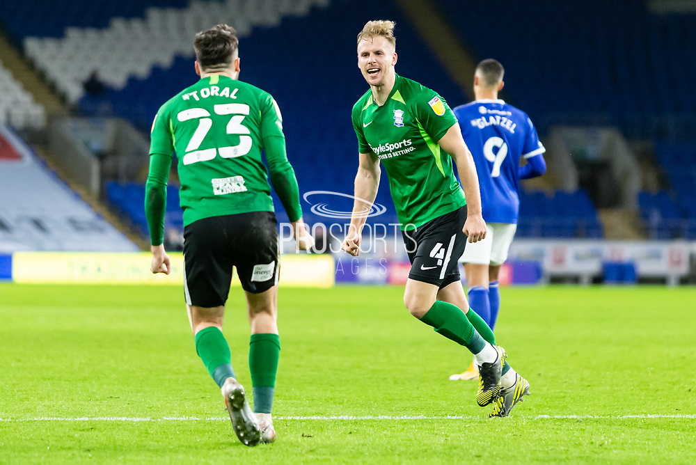 CELE Birmingham City's Marc Roberts (4) celebrates with Team Mate Jon Toral (23) during the EFL Sky Bet Championship match between Cardiff City and Birmingham City at the Cardiff City Stadium, Cardiff, Wales on 16 December 2020.