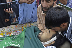 August 2, 2017 - India - A friend of Akeel Ahmed Bhat, crying near the dead body in Haal village, south of Srinagar, Akeel sustained serious injuries when government force fired pellet and bullets on protester during clashes in hall village ,he later succumbed to  injuries at local hospital in Indian controlled Kashmir. (Credit Image: © Umer Asif/Pacific Press via ZUMA Wire)