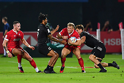 Ben Cambriani of Wales is tackled by Scott Curry of New Zealand <br /> <br /> Photographer Craig Thomas/Replay Images<br /> <br /> World Rugby HSBC World Sevens Series - Day 1 - Thursday 5rd December 2019 - Sevens Stadium - Dubai<br /> <br /> World Copyright © Replay Images . All rights reserved. info@replayimages.co.uk - http://replayimages.co.uk