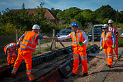 Leo Murray, director of innovation at 10:10 Climate Action shaking hands with Stuart Kistruck director of asset management for network rail Wessex route over the array of solar panels next to the line near Aldershot Railway Station.  This innovative project is the first in the UK to power the railway with electricity generated from solar power and, if successful, could see many Network Rail sites across the country adapting this sustainable energy approach. Riding Sunbeams is a social enterprise, run by 10:10 Climate Action. Built with Community Energy South and partnered with Network Rail and The Department for Transport and by InnovateUK.  Aldershot, Hampshire, United Kingdom. Riding Sunbeams is a world leading project to connect solar panels directly into electrified rail routes to power the trains. Direct supply of solar power to rail traction systems has never been done. But it has huge potential - from metros, trams and railways in the UK and around the world.<br /> (photo by Andrew Aitchison / In Pictures via Getty Images)