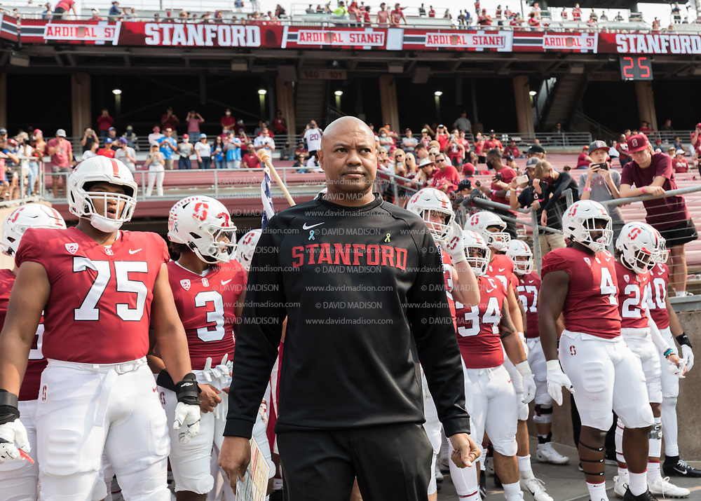 PALO ALTO, CA - SEPTEMBER 26:  Head Coach David Shaw of the Stanford Cardinal waits with his team before entering the field at the start of  an NCAA Pac-12 college football game against the UCLA Bruins on September 26, 2021 at Stanford Stadium in Palo Alto, California; visible players include Walter Rouse #75, Houston Heimuli #34, Thomas Booker #4..  (Photo by David Madison/Getty Images)