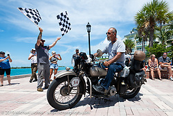 Don Baker riding his 1941 Indian 741B over the finish line of the Cross Country Chase motorcycle endurance run from Sault Sainte Marie, MI to Key West, FL. (for vintage bikes from 1930-1948). The Grand Finish in Key West's Mallory Square after the 110 mile Stage-10 ride from Miami to Key West, FL and after covering 2,368 miles of the Cross Country Chase. Sunday, September 15, 2019. Photography ©2019 Michael Lichter.