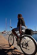 Young brazilian woman in her bike, La Savina, Formentera