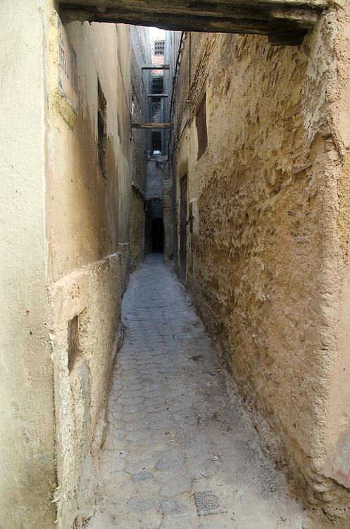Narrow alleyway in Fes medina, Morocco