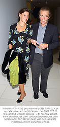 Writer MARTIN AMIS and his wife ISABEL FONSECA at a party in London on 5th September 2002.PCZ 75