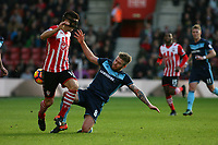 Football - 2016 / 2017 Premier League - Southampton vs. Middlesbrough<br /> <br /> Adam Clayton of Middlesbrough stops Southampton's Dusan Tadic from setting up a Southampton attack at St Mary's Stadium Southampton England<br /> <br /> COLORSPORT/SHAUN BOGGUST