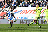 Will Grigg of Wigan Athletic shoots wide. Skybet football league one match , Wigan Athletic v Southend Utd at the DW Stadium in Wigan, Lancs on Saturday 23rd April 2016.<br /> pic by Chris Stading, Andrew Orchard sports photography.