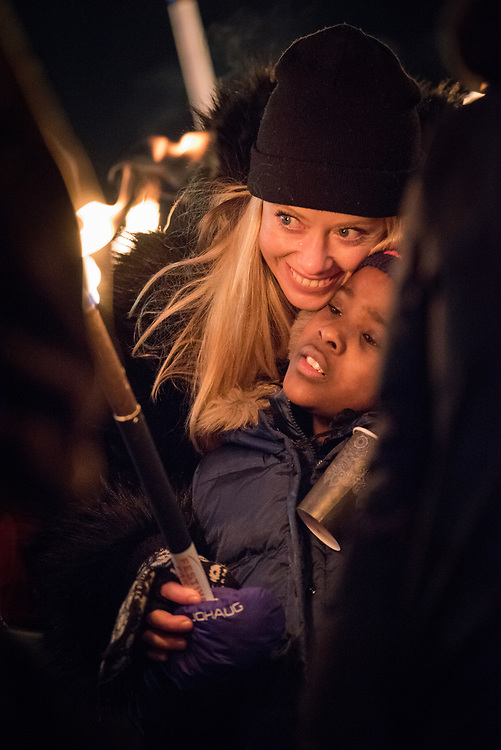 """10 December 2017, Oslo, Norway: In the evening of 10 December some 4,000 people from around the world gathered in central Oslo for a torch light march for peace. The event took place after the Nobel Peace Prize award 2017, awarded to the International Campaign to Abolish Nuclear Weapons (ICAN), for """"its work to draw attention to the catastrophic humanitarian consequences of any use of nuclear weapons and for its ground-breaking efforts to achieve a treaty-based prohibition of such weapons"""". Among the crowd were more than 20 """"Hibakusha"""", survivors of the atomic bombings in Hiroshima and Nagasaki, as well as a range of activists, faith-based organizations and others who work or support work for peace, in one or another way. Here, Merete (mother) and Alma, child, who have joined the march to support the peace work that ICAN and its partners do."""