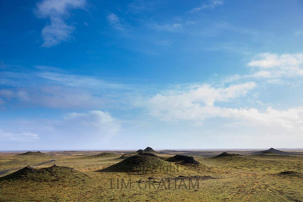 Lava mounds in green landscape in South Iceland