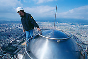 Engineer Hsiao-Pin Chen sits atop the 1,671 foot, 508m building.