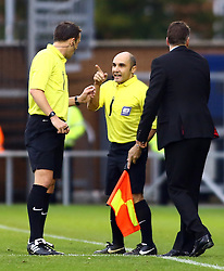 Linesman Mr M Buonassisi informs the match referee Mr Stuart Attwell about Peterborough United's Lee Tomlin after an off the ball incident led to the Tomlin being sent off - Photo mandatory by-line: Joe Dent/JMP - Tel: Mobile: 07966 386802 26/10/2013 - SPORT - FOOTBALL - Colchester Community Stadium - Colchester - Colchester United v Peterborough United - Sky Bet League One