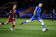 Peterborough United midfielder Marcus Maddison (21) gets in a shot  during  the The FA Cup 2nd round match between Peterborough United and Bradford City at London Road, Peterborough, England on 1 December 2018.