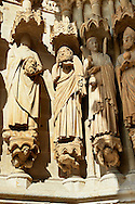 Gothic statues  decapitated martyrs Victoricus and Gentian, at the western entrance. Gothic Cathedral of Notre-Dame, Amiens, France . The Cathedral Basilica of Our Lady of Amiens or simply Amiens Cathedral, is a Roman Catholic  cathedral the seat of the Bishop of Amiens. It is situated on a slight ridge overlooking the River Somme in Amiens. Amiens Cathedral, was built almost entirely between 1220 and c.1270, a remarkably short period of time for a Gothic cathedral, giving it an unusual unity of style. Amiens is a classic example of the High Gothic style of Gothic architecture. It also has some features of the later Rayonnant style in the enlarged high windows of the choir, added in the mid-1250s. Amiens Cathedra has been listed as a UNESCO World Heritage Site since 1981. Photos can be downloaded as Royalty Free photos or bought as photo art prints. <br /> <br /> Visit our MEDIEVAL PHOTO COLLECTIONS for more   photos  to download or buy as prints https://funkystock.photoshelter.com/gallery-collection/Medieval-Middle-Ages-Historic-Places-Arcaeological-Sites-Pictures-Images-of/C0000B5ZA54_WD0s