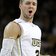 Central Florida guard A.J. Rompza (3) yells after a foul is called during an NCAA basketball game against the Furman Paladins at the UCF Holiday Classic at the UCF Arena on December 29, 2010 in Orlando, Florida. (AP Photo/Alex Menendez)