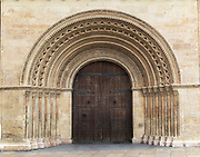 Arched doorway of the cathedral church building in city of Valencia, Spain