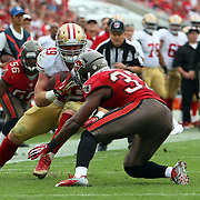 San Francisco 49ers fullback Bruce Miller (49) gets injured during an NFL football game between the San Francisco 49ers  and the Tampa Bay Buccaneers on Sunday, December 15, 2013 at Raymond James Stadium in Tampa, Florida.. (Photo/Alex Menendez)