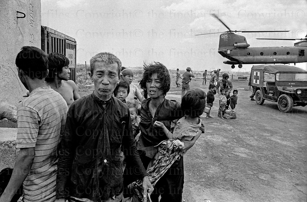 Scared refugees arrive by USA chinook helicopter after being evacuated from the besieged town of Xuan Loc as the North Vietnamese army advance.April 1975.  The Vietnam War was fought between 1st November 1955 until the fall of Saigon on 30 April 1975. Photographed by award winning photographer Terry Fincher. Contact thefincherfiles@btinternet.com for publication fees and permissions.