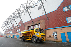 Snow falls outside Turf Moor as a gritter is seen before the Premier League match at Turf Moor, Burnley.