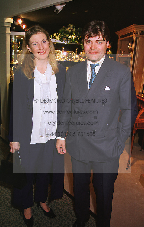 LORD & LADY PORCHESTER at an antiques fair in London on 9th June 1999.<br /> MSY 96