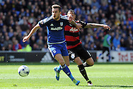 Cardiff City's Joe Ralls (l) is challenged by QPR's Tjaronn Chery. Skybet football league championship match, Cardiff city v Queens Park Rangers at the Cardiff city stadium in Cardiff, South Wales on Saturday 16th April 2016.<br /> pic by Carl Robertson, Andrew Orchard sports photography.