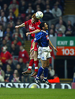 Fotball: Liverpool John Arne Riise wins a header with a Birmingham City player during the FA Cup 3rd Round match at Anfield. Liverpool won 3-0. Saturday 5th January 2002.<br /><br />Foto: David Rawcliffe, Digitalsport