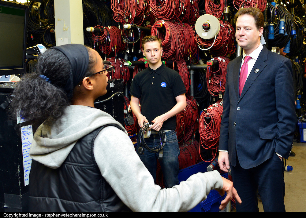 © Licensed to London News Pictures. 14/03/2013. London, UK Deputy Prime Minister Nick Clegg talks to two apprentices testing theatrical wiring whilst he visits White Light, a company in South West London, to talk to apprentices and launch the Government's response to the Richard Review today 14th March 2013. Photo credit : Stephen Simpson/LNP