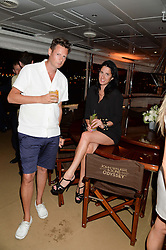 The Johnnie Walker Gold Label Reserve Party aboard John Walker & Sons Voyager, St.Georges Stairs Tier, Butler's Wharf Pier, London, UK on 17th July 2013.<br /> Picture Shows:-Amy Molyneaux & Percy Parker.