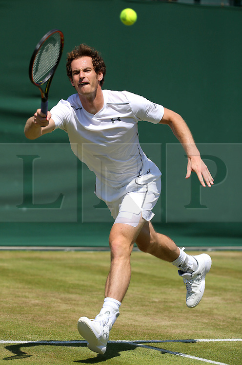 © London News Pictures. 09/07/2015. Andrew Murray trains with coach Amelie Mauresmo a day before he plays Roger Federer in the semi finals in the Wimbledon Tennis Championships. Photo credit: LNP