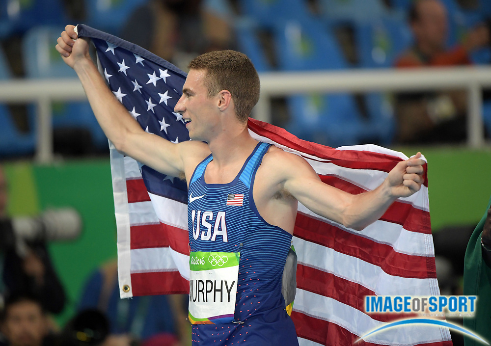 Aug 15, 2016; Rio de Janeiro, Brazil; Clayton Murphy (USA) takes victory lap with United States flag after placing third in the 800m in 1:42.93 at Estadio Olimpico Joao Havelange in the Rio 2016 Summer Olympic Games.