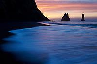 Sunrise at Reynisfjara black sand beach. Reynisdrangar Sea Stacks in background. South Iceland.