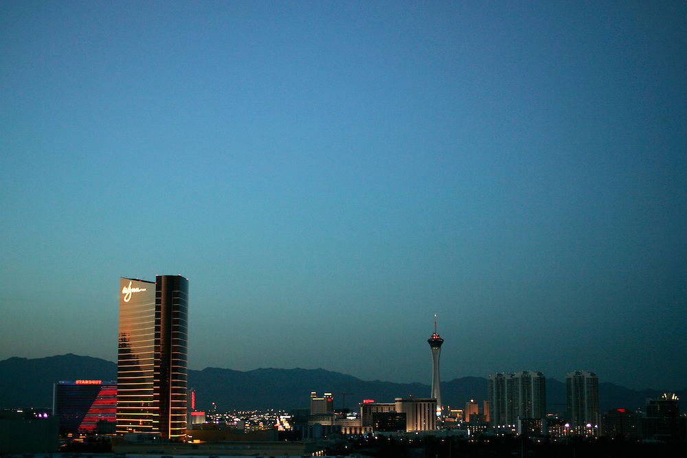 The Las Vegas, Nevada skyline at dusk includes the Wynn resort and casino as well as teh Stratosphere